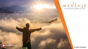 A positive man high up on a mountain facing the morning sun with his two hands outstretched from side to side giving a thumbs up on each hand. El Mensaje logo on the right of the image and includes English Subtitles for the episode.