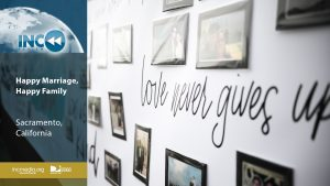 A wall of photos of couples with the words love never give up written on it.