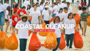 Volunteers with bags of trash picked up from the coast