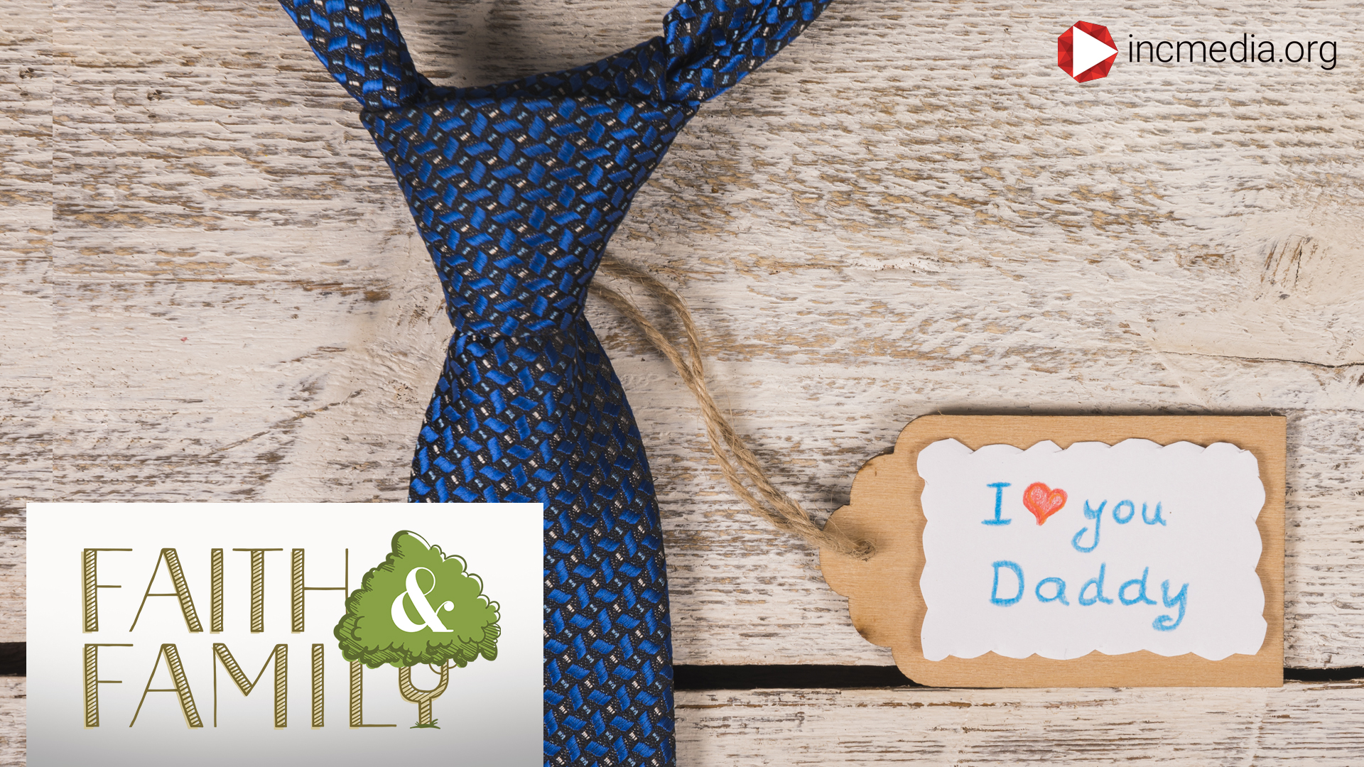 "blue necktie against wood with tag that says ""i love you daddy"""
