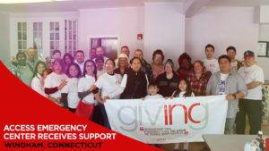 Group of volunteers holding INCGiving sign with overlay text Access Emergency Center Receives Support. Windham, Connecticut