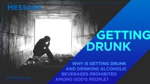 "Silhouette of man sitting under an overpass with his head in his hands with text overlay on blue diagonal ribbon shape with text overlay: ""Getting drunk - why is getting drunk and drinking alcoholic beverages prohibited among God's people?"""